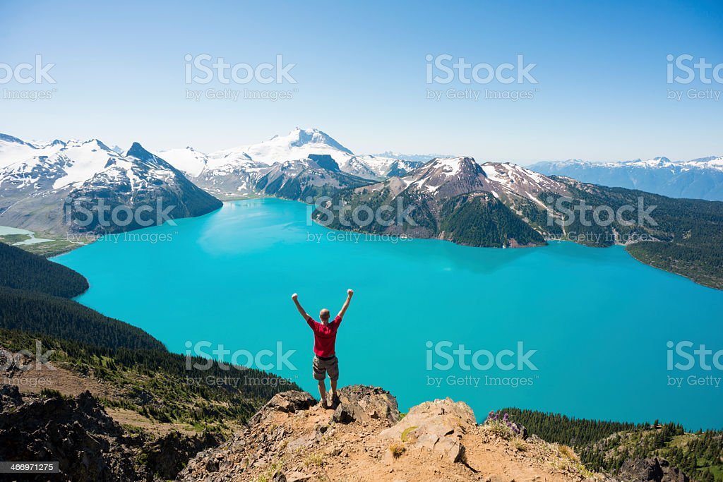 Person standing on cliff enjoy beautiful view of nature stock photo