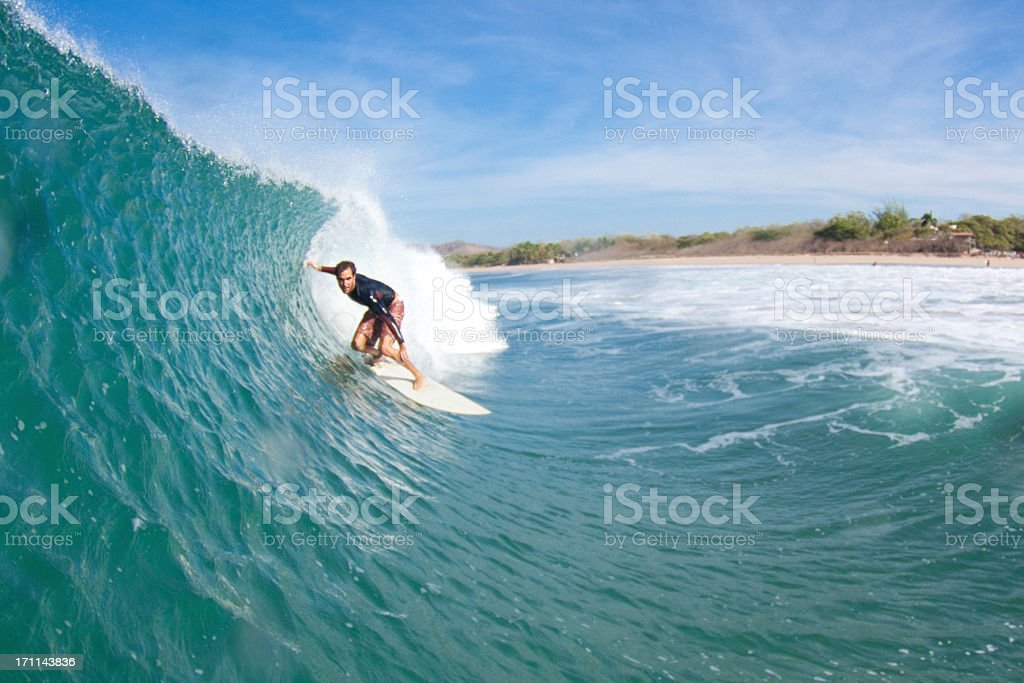 A person surfing on a wave in the ocean royalty-free stock photo