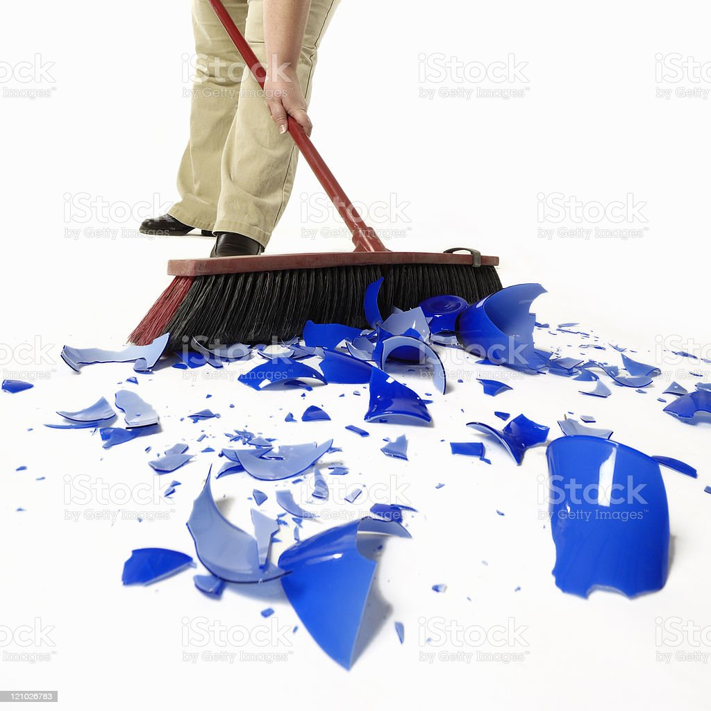 person sweeping-up broken glass royalty-free stock photo