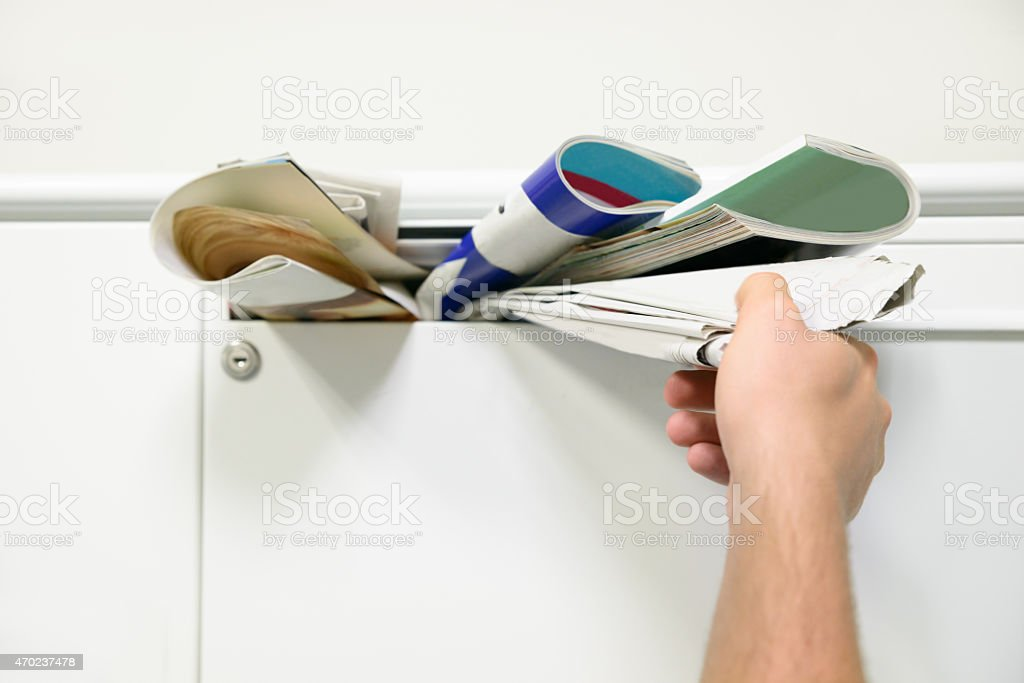Person Taking Documents From Mailbox stock photo