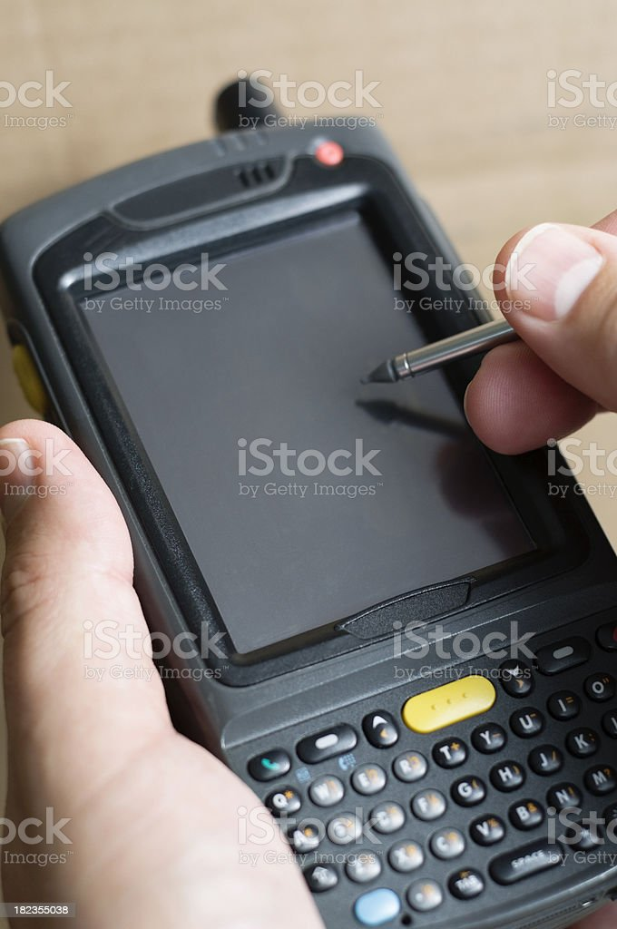 Person Taking Inventory Using Barcode Scanner Computer stock photo