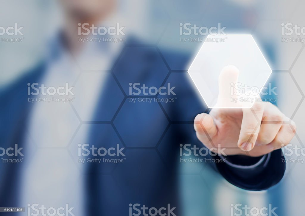 Person touching an hexagonal button on a digital interface stock photo
