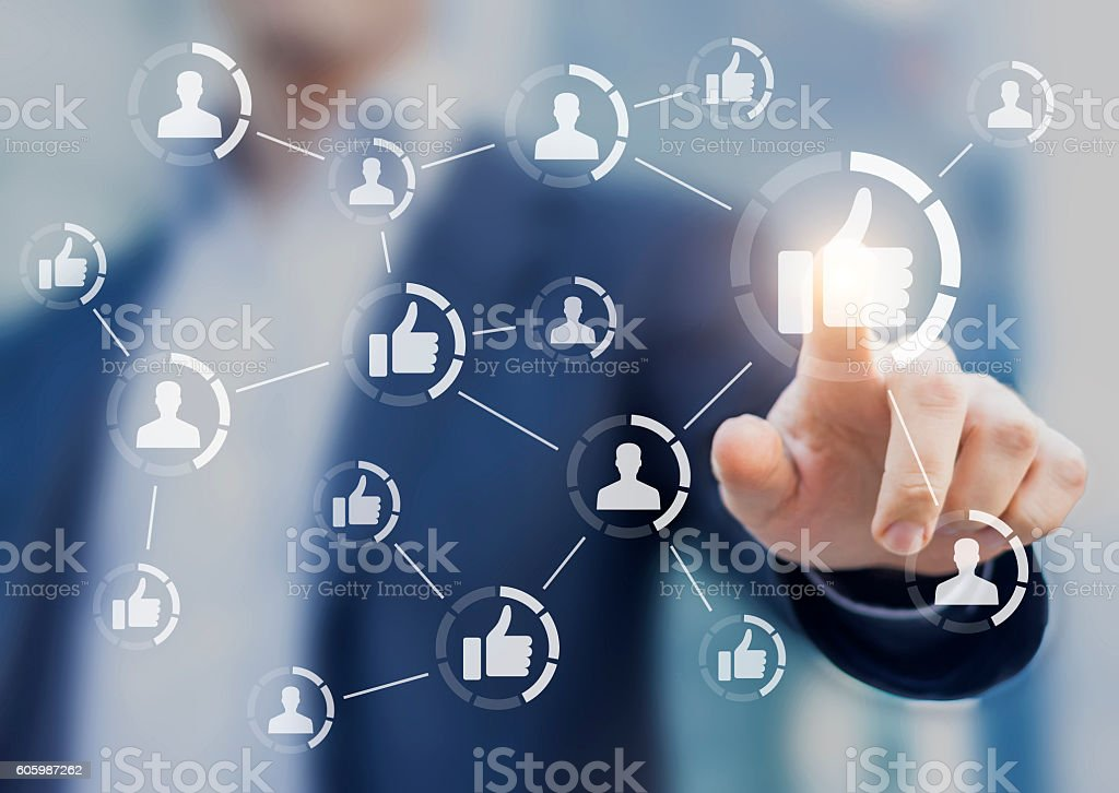 Person touching like buttons. Concept about social media network stock photo