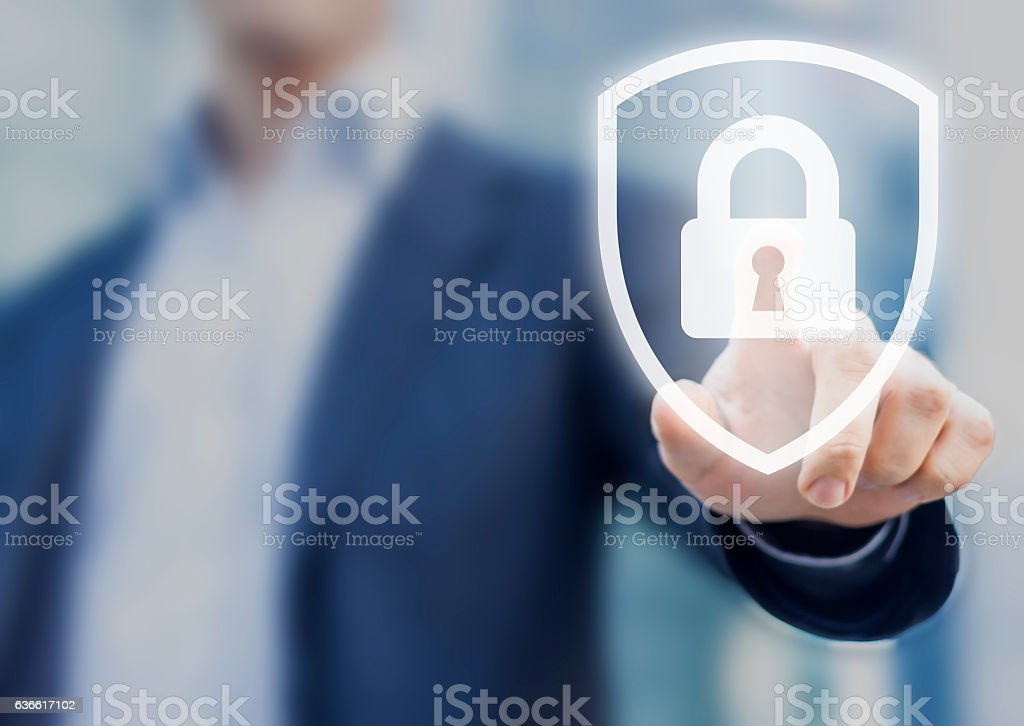 Person touching shield with lock, concept about security, cybersecurity, protection stock photo