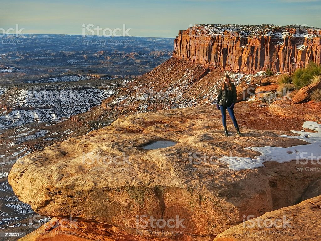 Person, Tourist, Mesa Bluff Cliff, Canyon, Canyonlands National Park, Utah stock photo