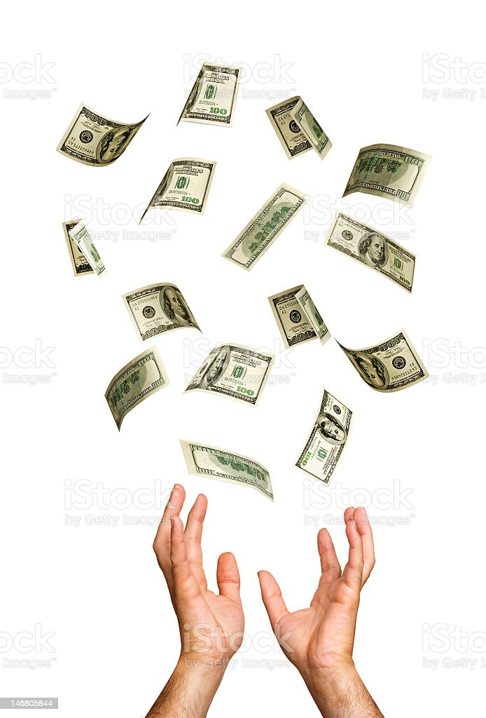 A person trying to catch money falling from the air  stock photo