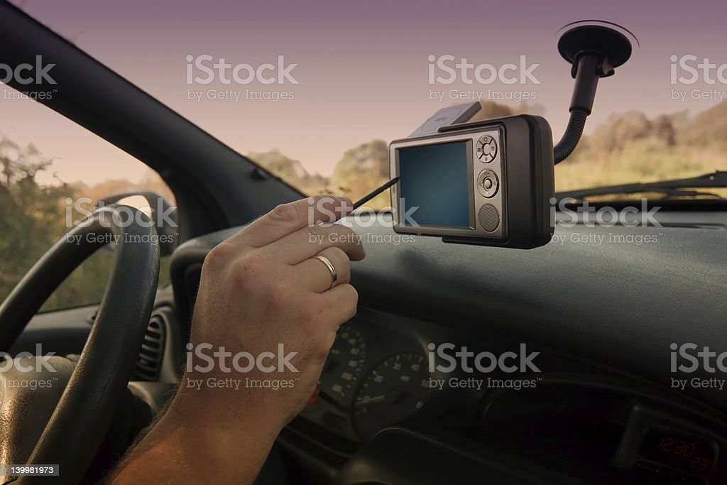Person using a GPS with a stylus while driving royalty-free stock photo