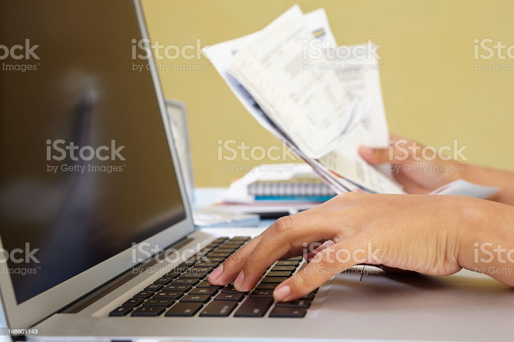 A person using a laptop for e-commerce stock photo