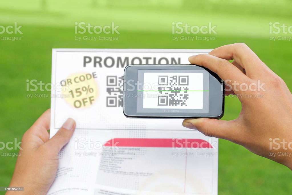 Person using a smartphone QR scanner to redeem a promotion stock photo