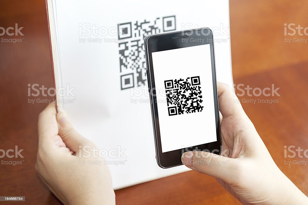 Person using mobile device to scan QR code stock photo
