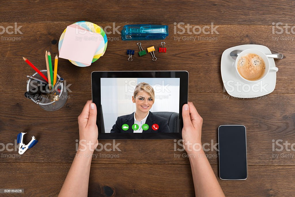 Person Videochatting On Digital Tablet stock photo