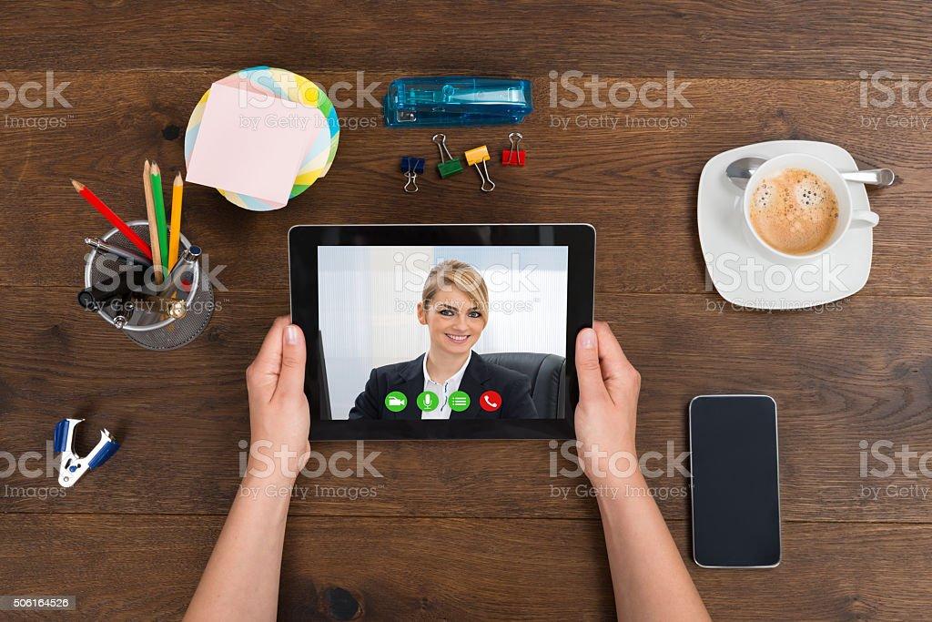 Person Videochatting On Digital Tablet stock photo