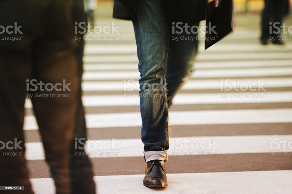 Person walking on zebra crossing royalty-free stock photo