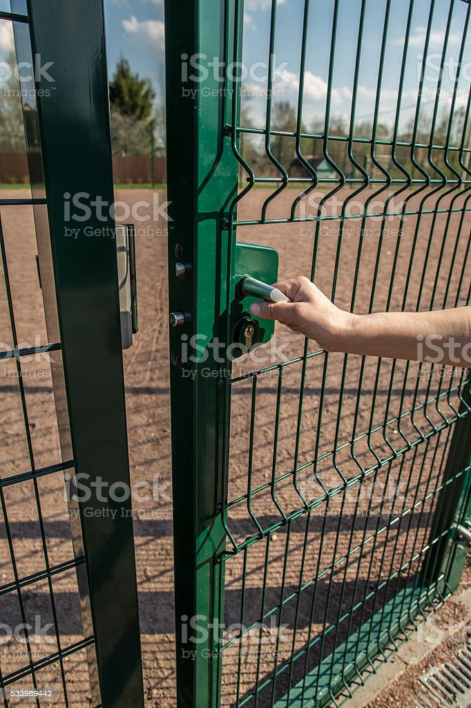person wants get in on playground through little gate stock photo