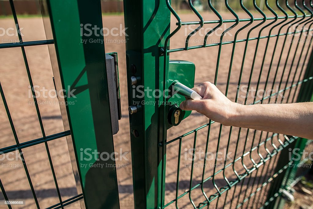 person wants get in on playground through the little gate stock photo