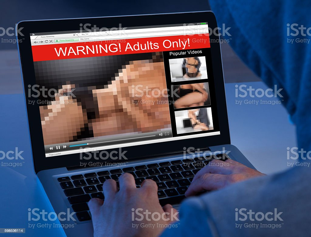 Person Watching Adult Movie On Laptop stock photo
