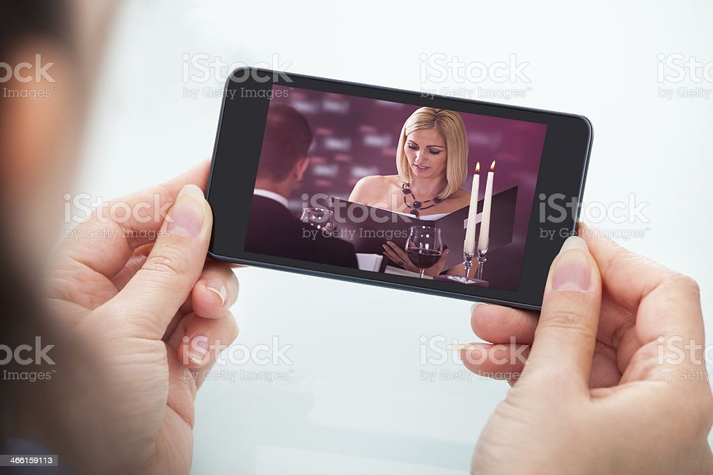 Person Watching Video On Cellphone stock photo