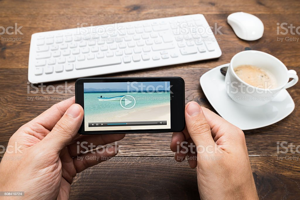 Person Watching Video On Mobile Phone stock photo