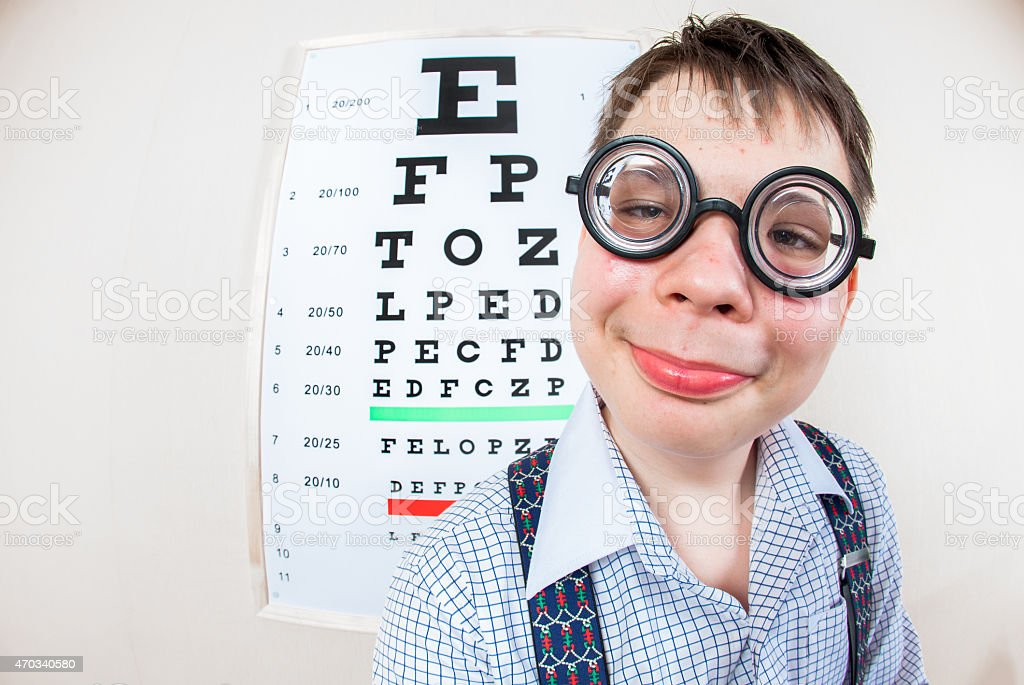 Person wearing spectacles in an office at the doctor stock photo