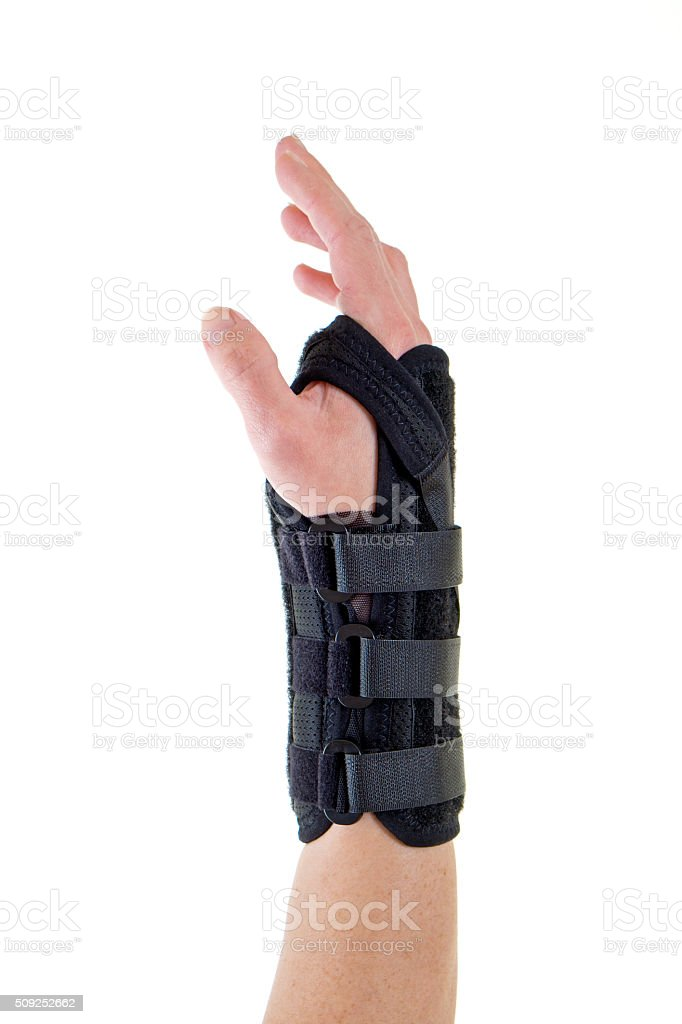Person Wearing Supportive Brace on Wrist. stock photo