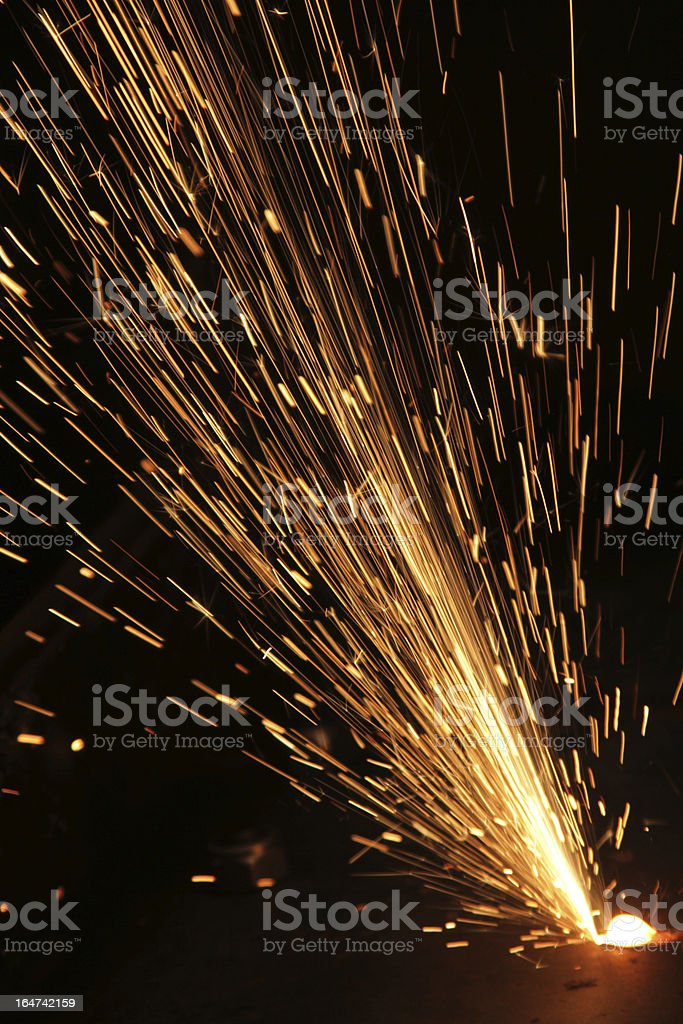 A person welding material together  stock photo