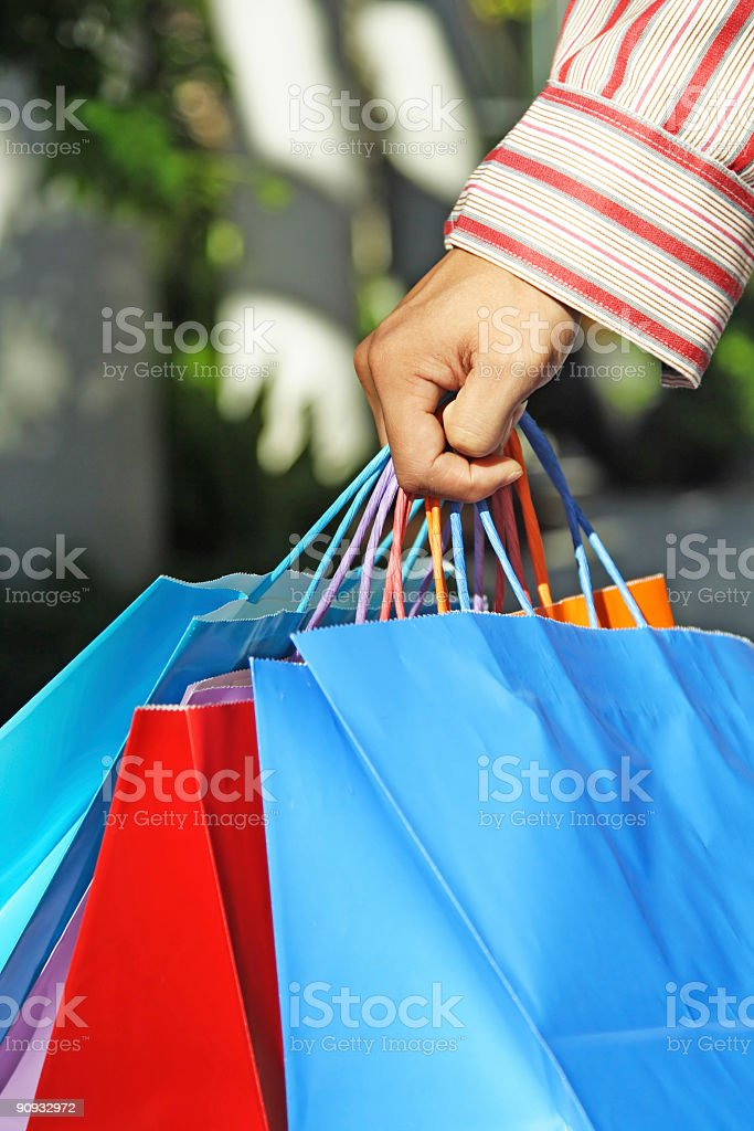 A person who has a lot of bags from shopping royalty-free stock photo