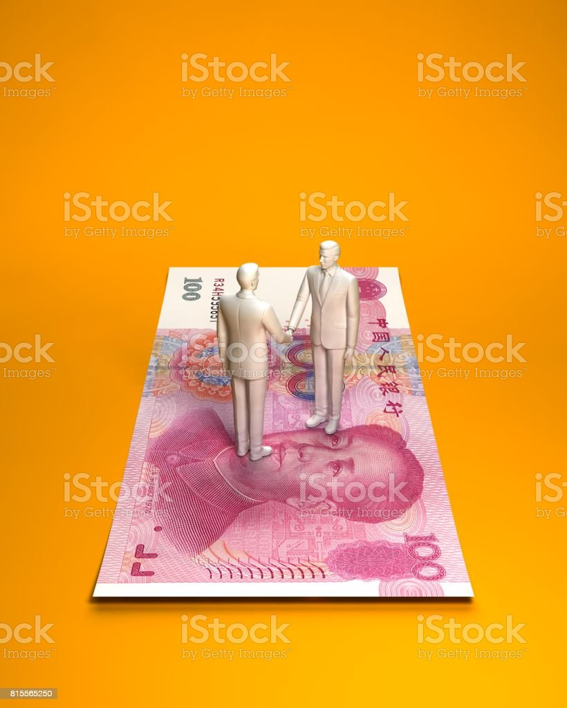 Person who shakes hands on Chinese banknotes stock photo