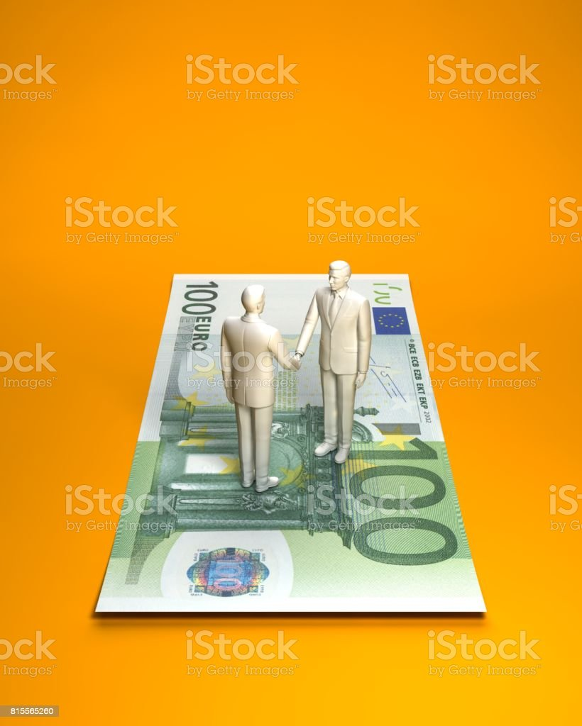 Person who shakes hands on euro banknotes stock photo