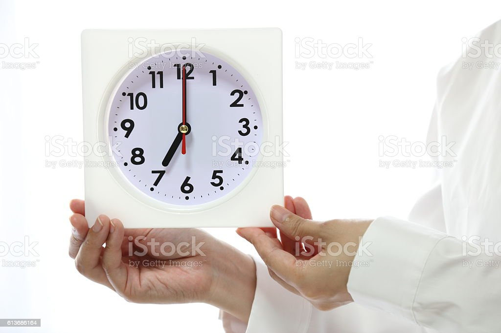 Person with a clock stock photo