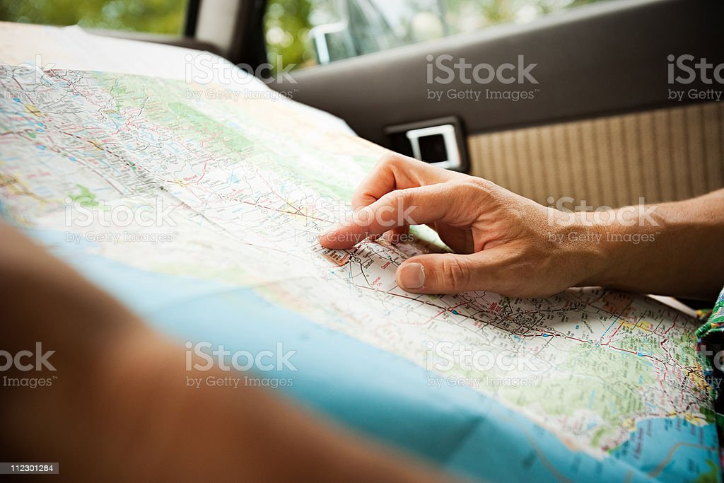Person with a map stock photo