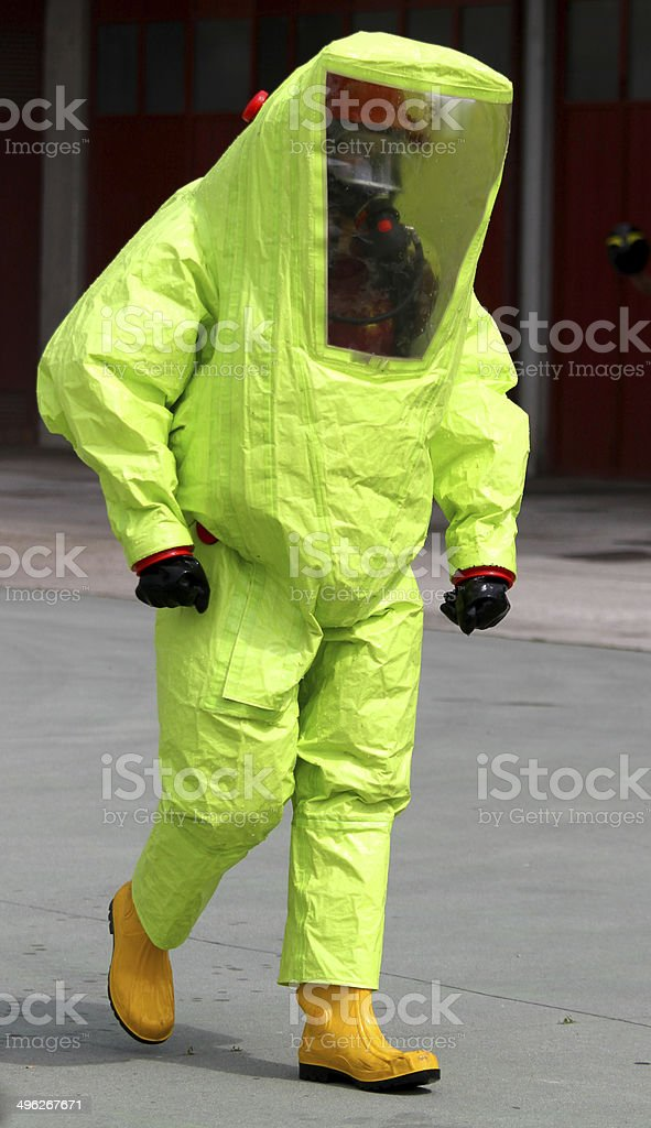 person with anti radiation suit yellow and yellow rubber boots stock photo
