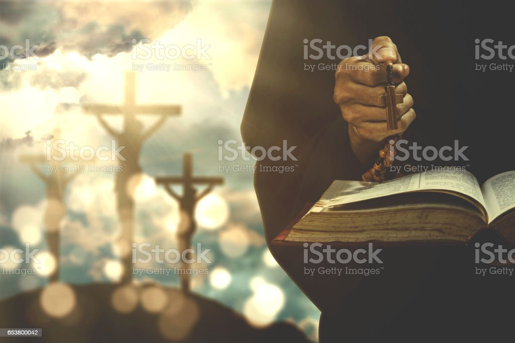 Person with bible and rosary stock photo