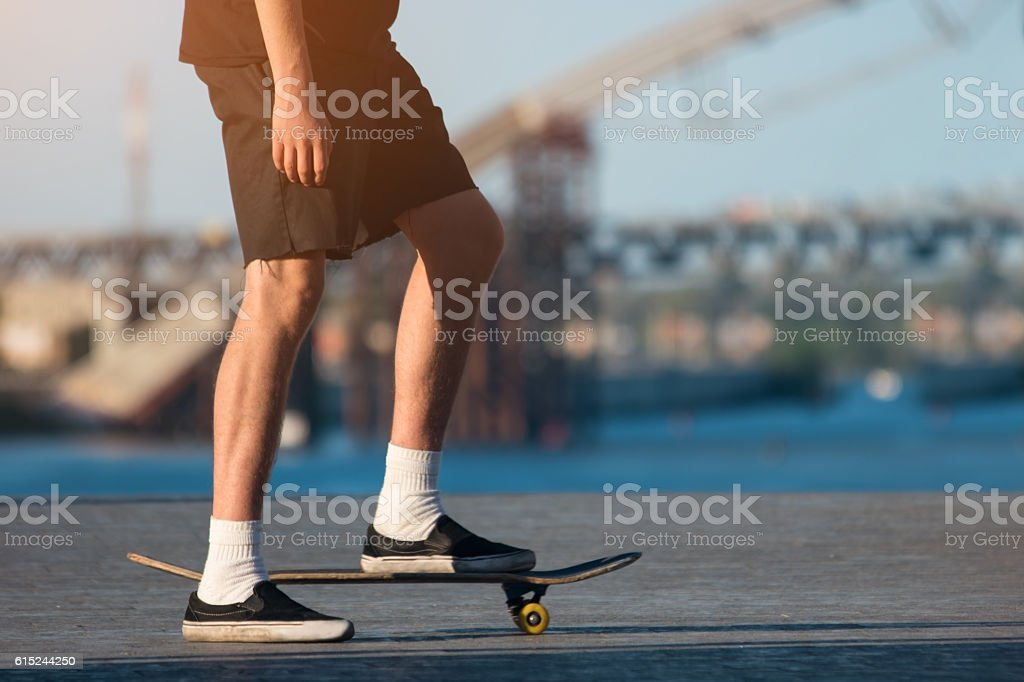 Person with skateboard outdoor. stock photo