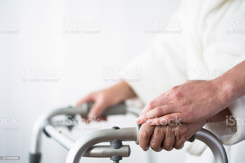 Person with walking aid stock photo