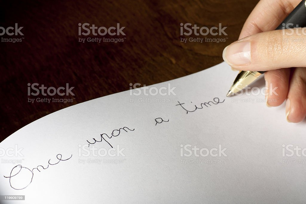 Person writing Once upon a time on blank paper royalty-free stock photo