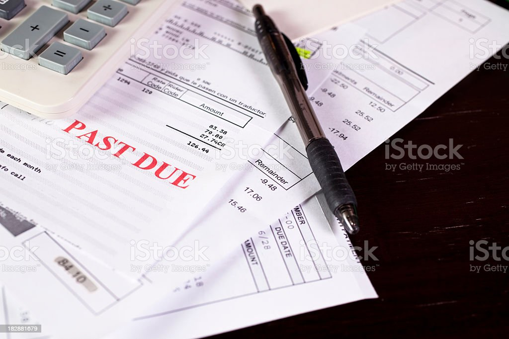 Personal bills and calculator. Past due notice. Home finances. stock photo