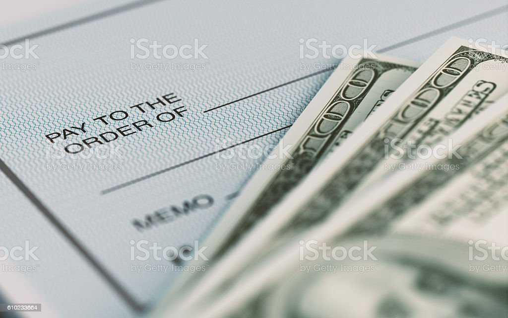 Personal Check and American Dollars With Selective Focus stock photo