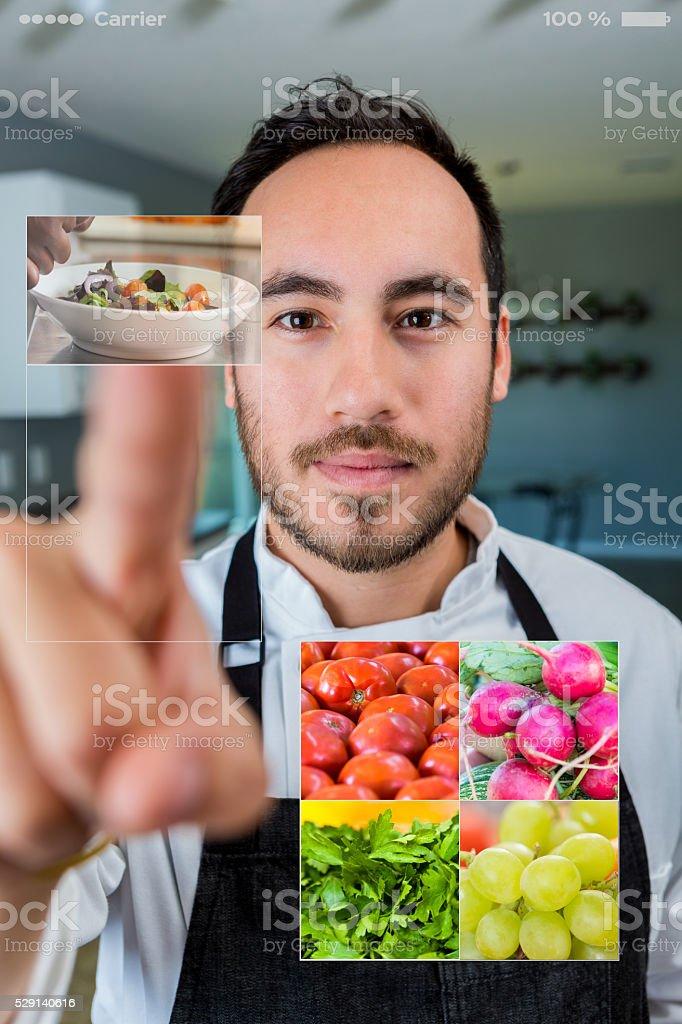 Personal chef chooses menu items stock photo