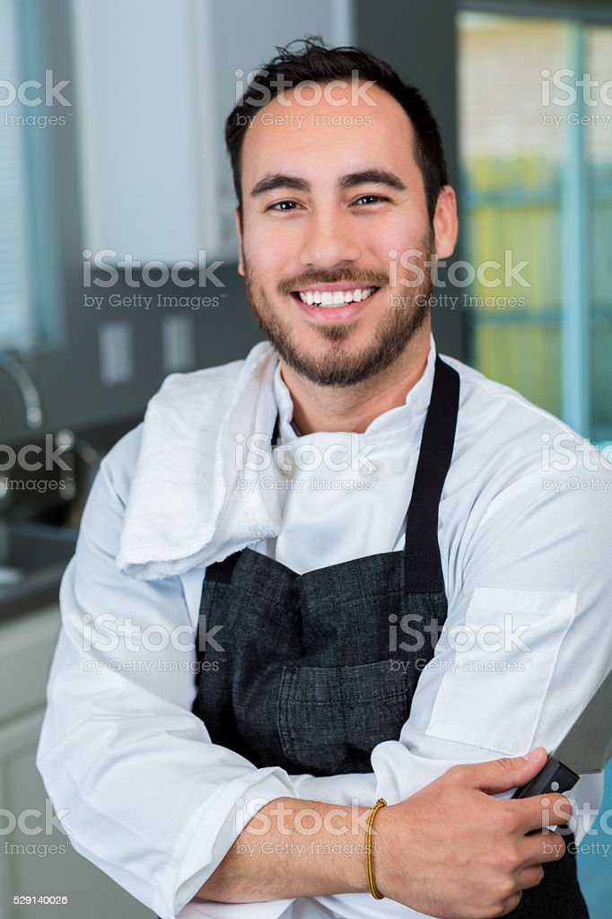 Personal chef in home kitchen stock photo