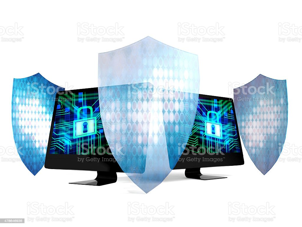 Personal computers protected by security system and technology shields stock photo
