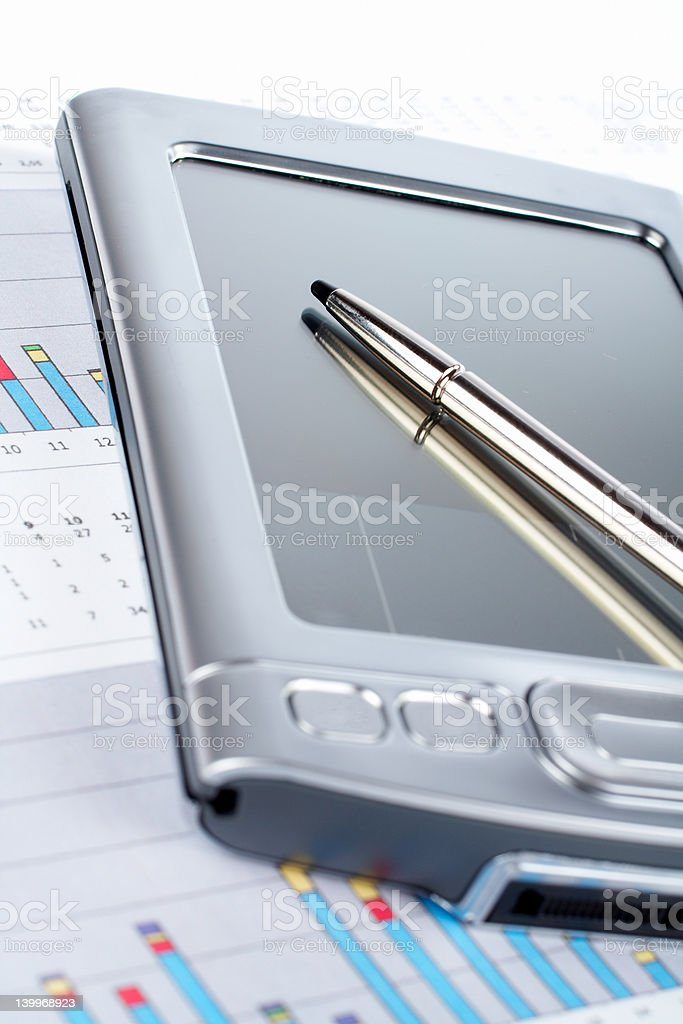 Personal digital assistant on market financial chart background royalty-free stock photo