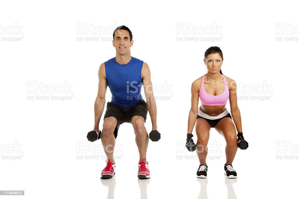 Personal Fitness Trainer with young woman royalty-free stock photo