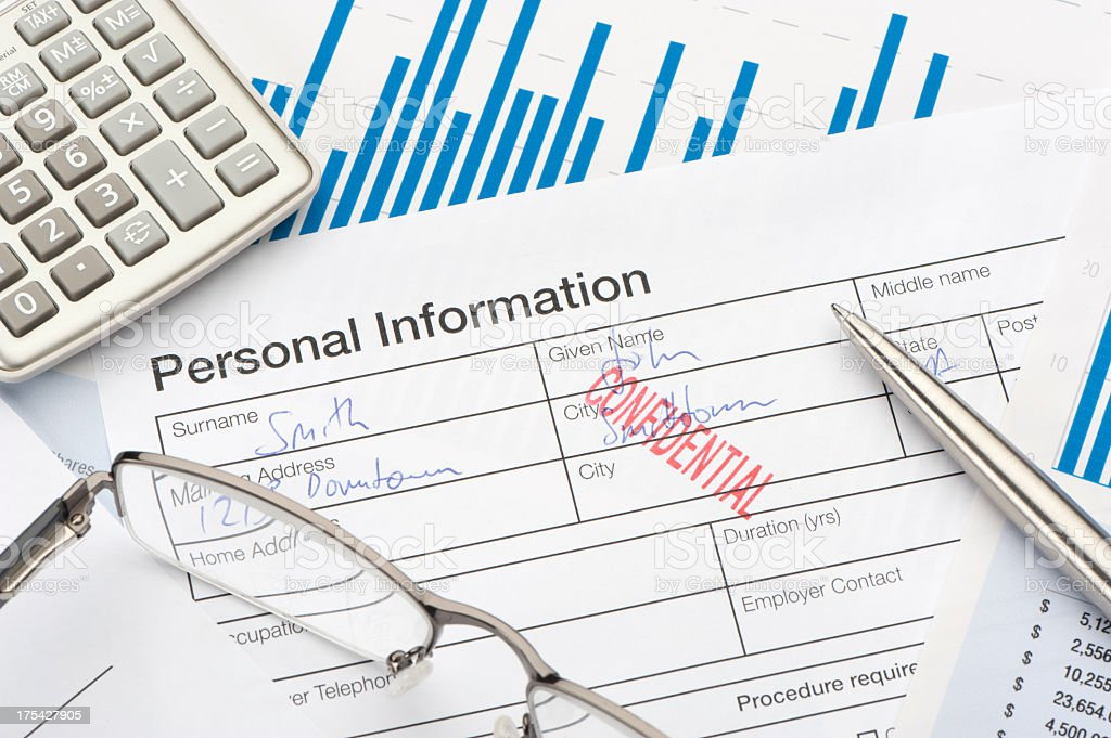 Personal information form with confidential stamp stock photo