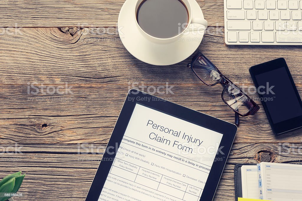 Personal injury claim form on a table. stock photo