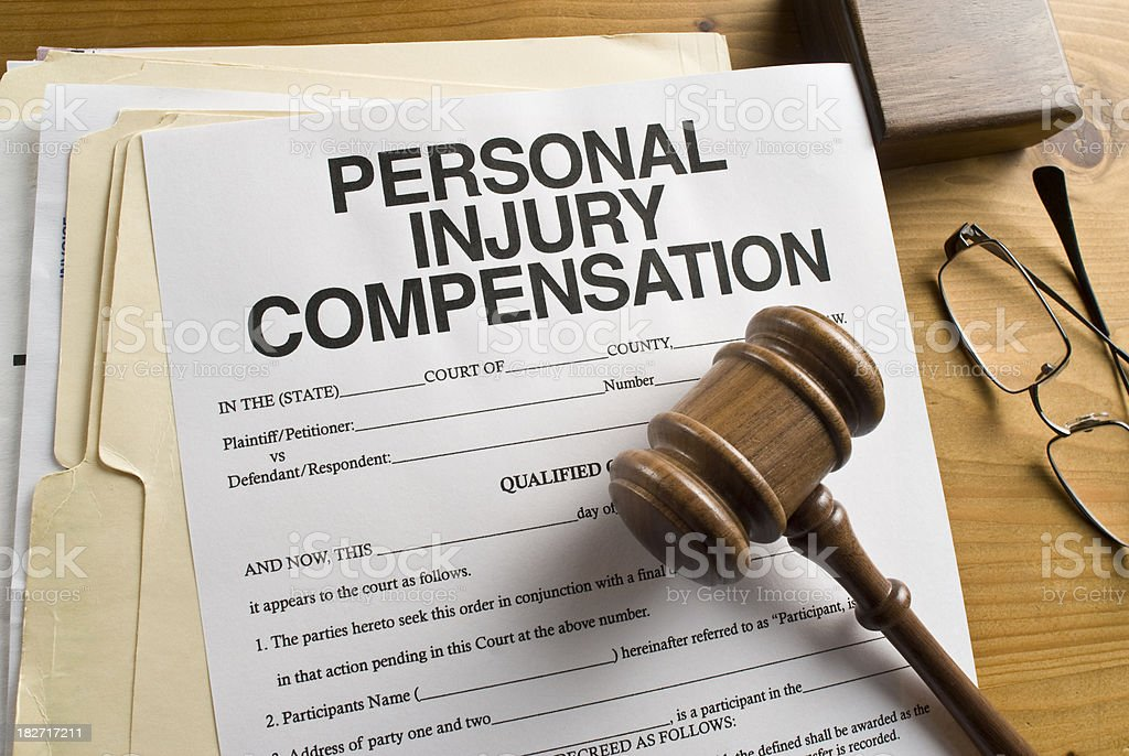 Personal Injury Compensation form with a gavel. royalty-free stock photo