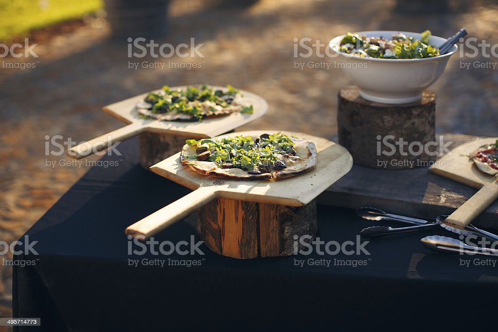 Personal Pan Pizzas in summer stock photo