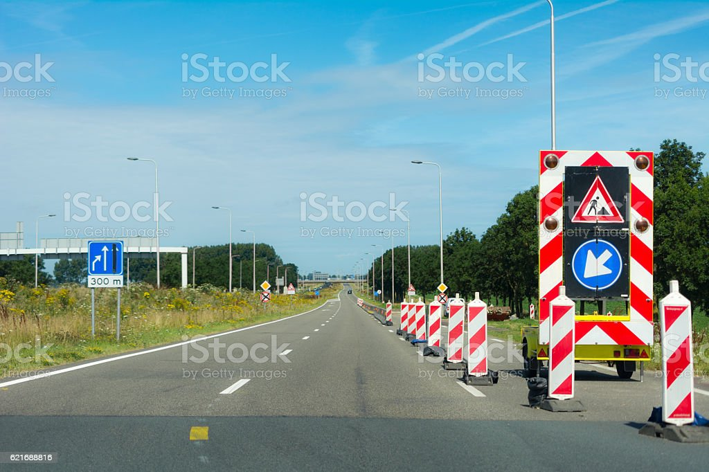 Personal perspective driver passing Mobile sign for roadworks stock photo