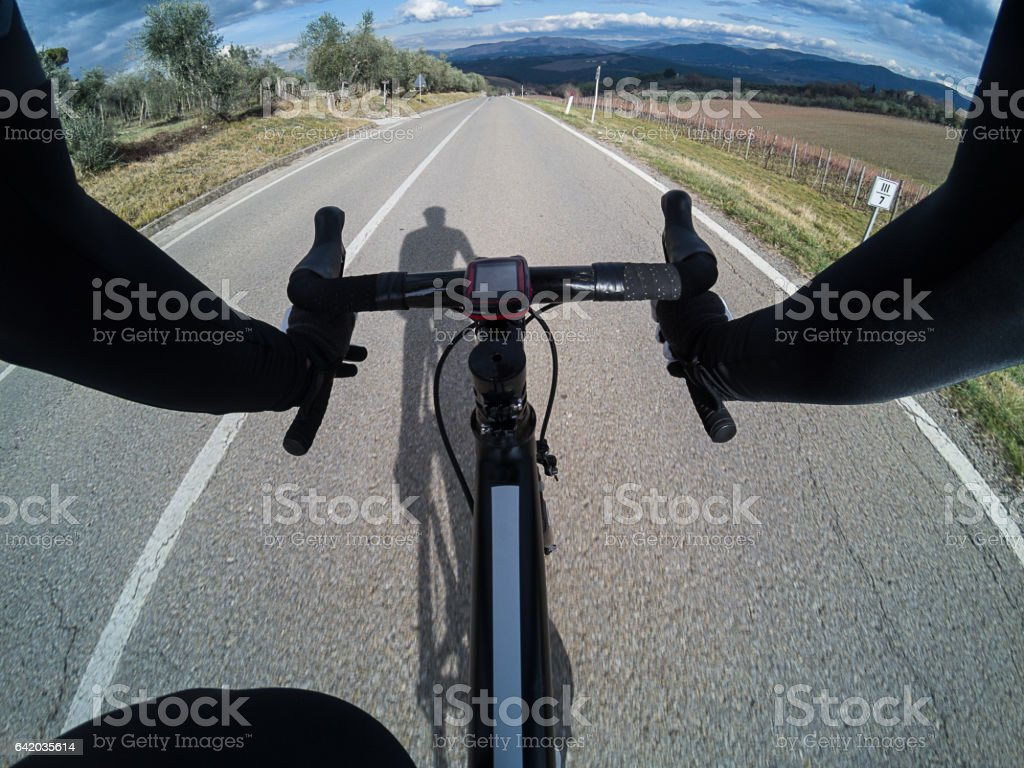 Personal perspective of a cyclist riding a road bike in Tuscany stock photo