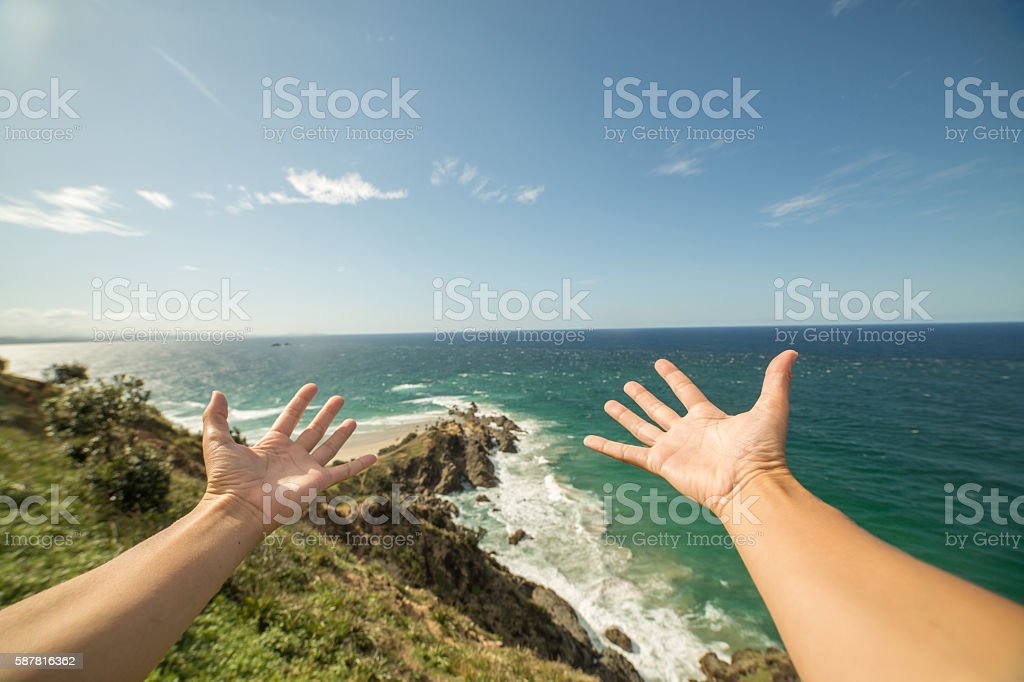 Personal perspective of female embracing ocean stock photo