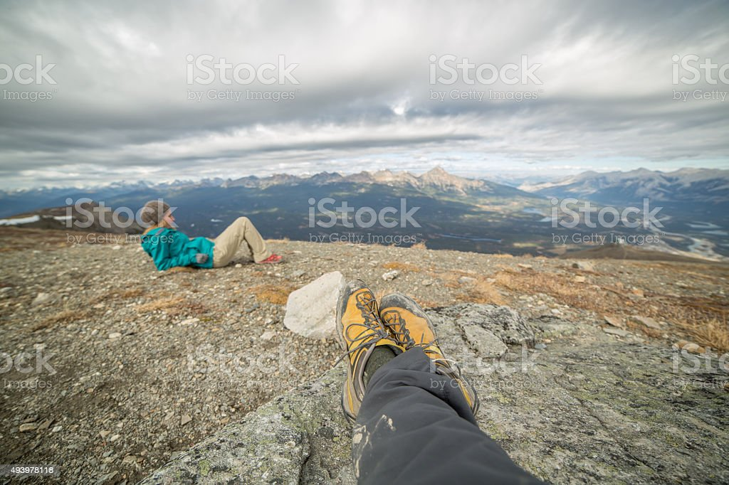 Personal perspective of hiker on mountain top stock photo